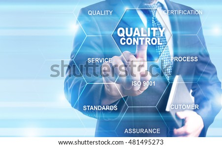 Businessman pressing on virtual screen and select Quality control concept.