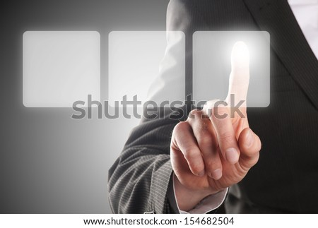 businessman pressing one of the tree buttons on a virtual background - stock photo