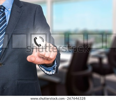 Businessman pressing phone button, visual screen. Communication concept. Isolated on office. Stock Image - stock photo