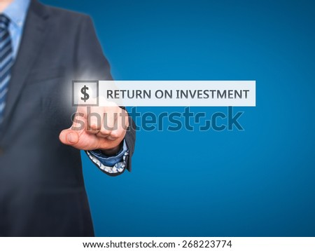 Businessman pressing Return on Investment button on virtual screens. Dollar icon. Isolated on blue. Business, technology and internet concept - Stock Image - stock photo