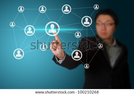 Businessman pressing simple start buttons on a touch screen - stock photo