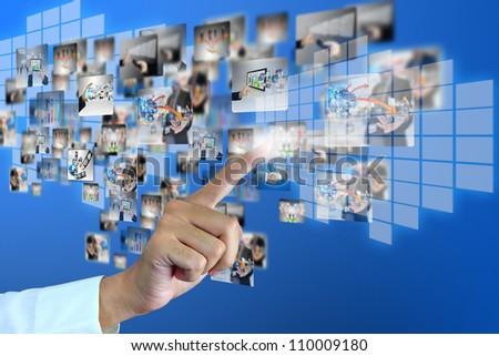 Businessman pressing social media - stock photo