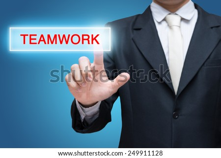Businessman pressing teamwork button isolated on over blue background - stock photo