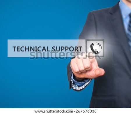 Businessman pressing technical support button on virtual screens. Phone Icon. Isolated on blue. Business, technology, internet and networking concept -  Stock Image - stock photo