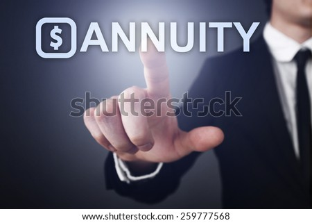 Businessman pressing touch screen interface and select annuity business concept. - stock photo