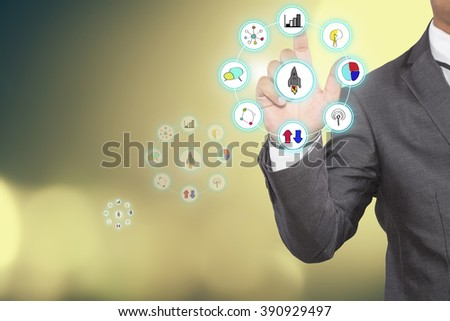 "Businessman pressing touch screen interface and select ""Business startup""."