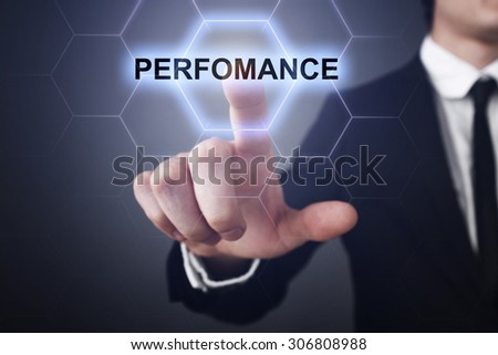 """Businessman pressing touch screen interface and select icon """"performance"""". Business concept. Internet concept. - stock photo"""