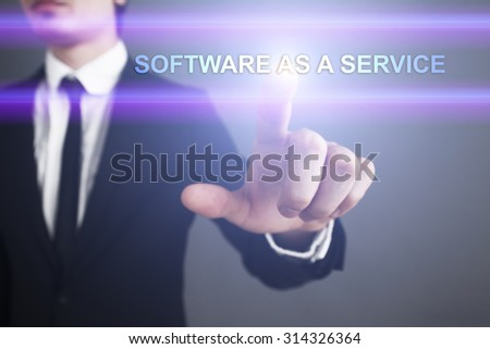 """Businessman pressing touch screen interface and select """"Software as a service"""". Business concept. Internet concept. - stock photo"""