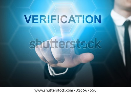 "Businessman pressing touch screen interface and select ""verification"".  - stock photo"