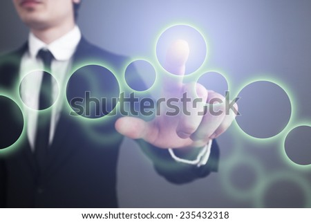 Businessman pressing touch screen interface. selects the circle
