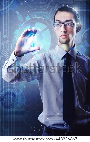 Businessman pressing virtual button in futuristic concept
