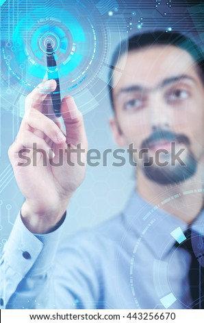 Businessman pressing virtual buttons in futuristic concept