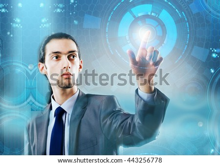 Businessman pressing virtual buttons in futuristic concept - stock photo