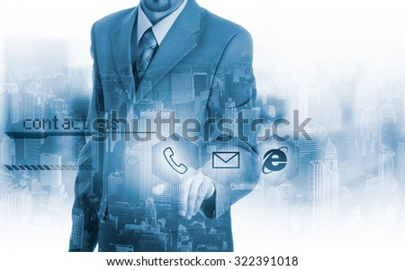 Businessman pressing virtual phone buttons. customer support concept. - stock photo