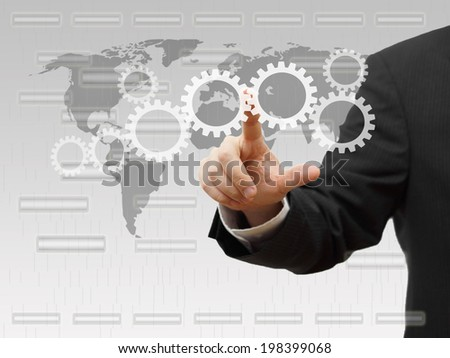 Businessman pressing virtual sprockets. technology and innovation concept - stock photo