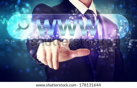 Businessman pressing WWW search button on blue background - stock photo