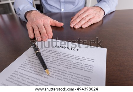Businessman proposing to sign a contract