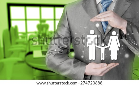 businessman protecting family Insurance concept - stock photo