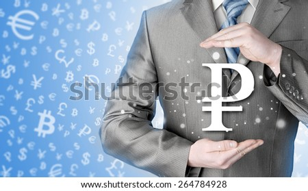 businessman protecting ruble symbol