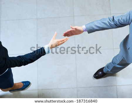 businessman pull his hands toward each other, the future handshake - stock photo