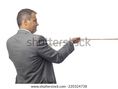businessman pulling a rope - stock photo