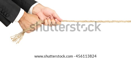 businessman pulling a rope isolated on white - stock photo