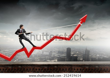 Businessman pulling arrow with rope and making it raise up - stock photo