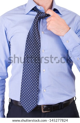 Businessman pulling his collar. - stock photo