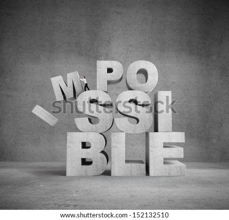 businessman pulling letters impossible concept in concrete room - stock photo