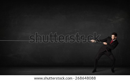 Businessman pulling rope on grey background concept - stock photo