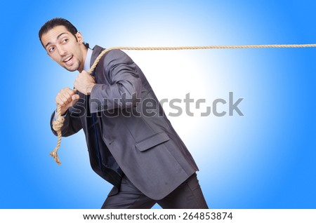 Businessman pulling rope on white - stock photo