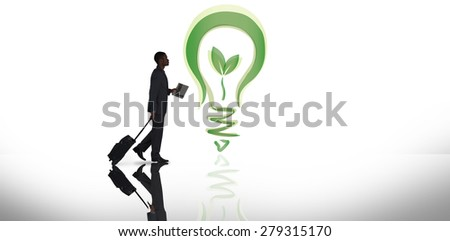 Businessman pulling suitcase against white background with vignette - stock photo