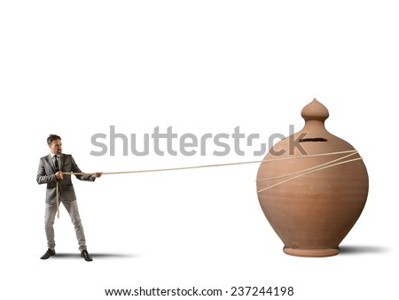 Businessman pulls a moneybox with a rope - stock photo