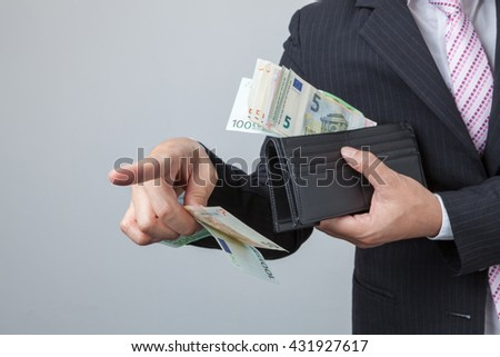 Businessman purse with Euro in their hands. Holding bangnotes out wallet.