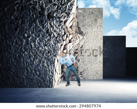 businessman push and destroy concrete wall - stock photo