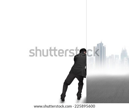 businessman push away cityscape wall with white empty space - stock photo