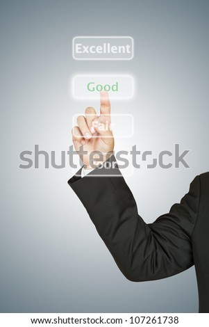 Businessman push Good button - stock photo