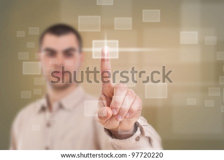 Businessman push high tech type of modern buttons on a virtual background