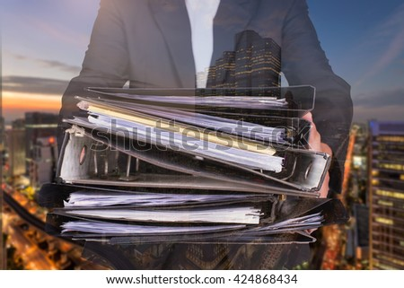 businessman push many file and city scape double exposure,Accounting and business concept - stock photo