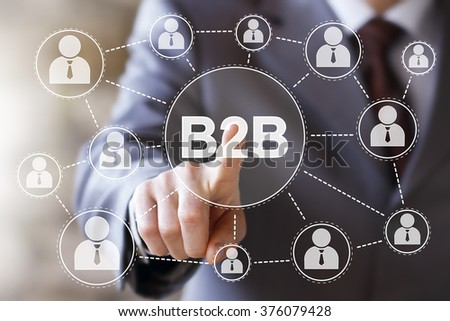 Businessman push online web B2B button - stock photo