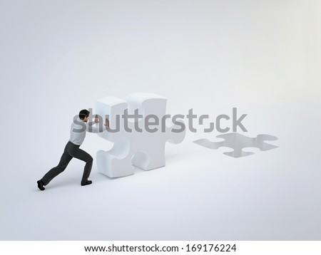 Businessman push puzzle - stock photo
