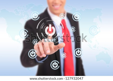 businessman push the start button on virtual touch pad