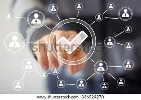 Businessman push virtual icon button Checked mark web - stock photo