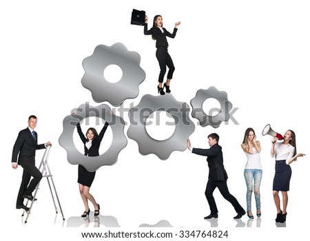 Businessman pushes metal gears , woman hangs on them, man climbs up on stepladder,isolated on the white background