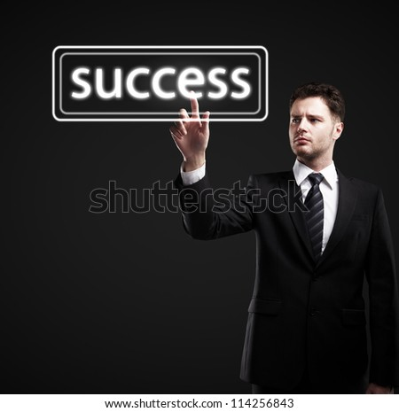 businessman pushes success on a black background