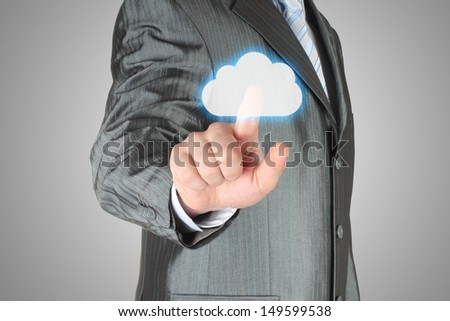 Businessman pushes virtual cloud button. Cloud computing concept   - stock photo