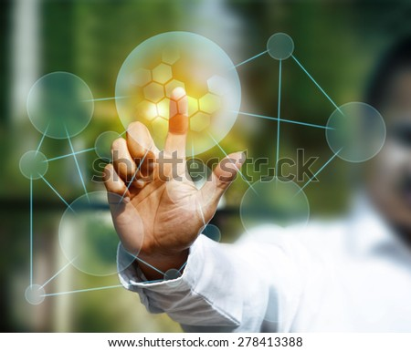 businessman pushing a touch screen interface - stock photo