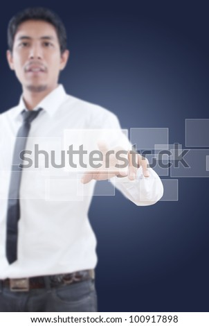 Businessman pushing Button on the whiteboard.
