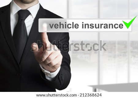 businessman pushing button vehicle insurance green checked - stock photo