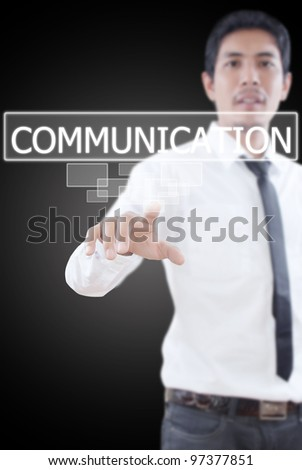 Businessman pushing Communication word on a touch screen interface.